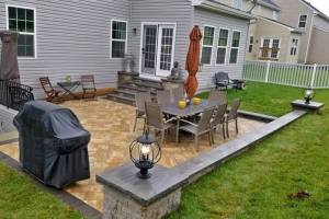 Patio with Sitting Wall and Outdoor Lighting